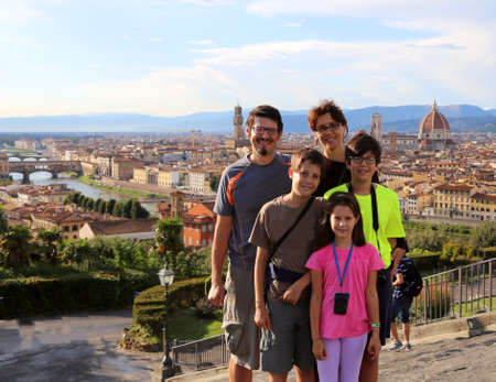 Happy family with five people and 3 children traveling to FLORENCE in italy Stock Photo
