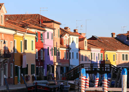 Burano is a little island near Venice in Italy famous for its brightly colored houses. Rainbow of many colors is an italian tourist attraction Stock Photo
