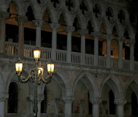 Venice in Italy by night Palace of Doge and a lampstreet with lights
