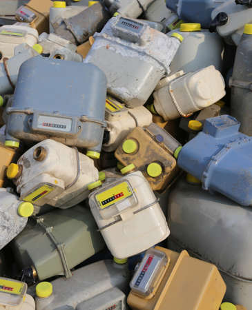 many discharged gas meter counters into a dump of hazardous and polluting material