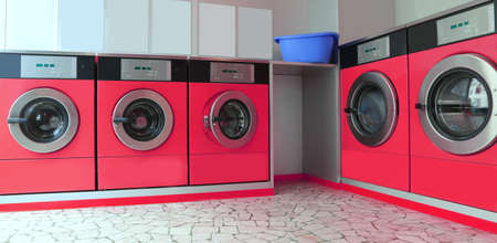 Automatic launderette with five big red washers for washing dirty cloths Stock Photo