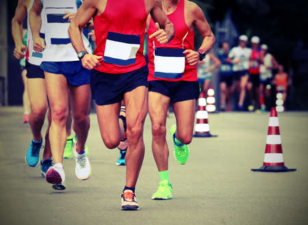 many runners run fast on the road with vintage effect during the marathon