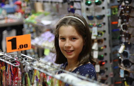 Pretty little girl while buying products in the store Stock Photo