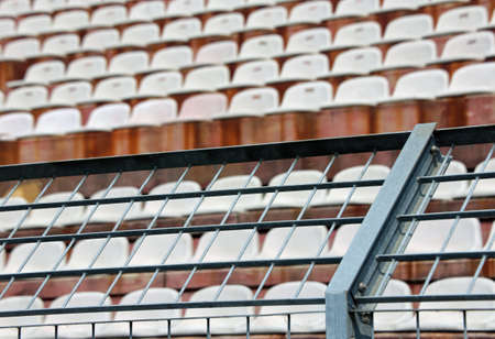 Robust metal mesh in the stadium to divide the fans on the stairs from the players during the sports meetings Stock Photo