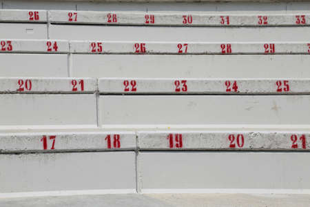 many numbers on the stairs in the stadium to indicate the seat during the sporting events