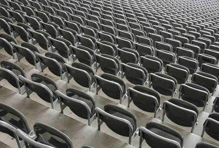 reclining chairs on the stadium bleachers with no people before the event of the live concert
