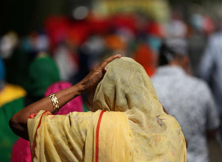 seniority: elderly woman with headscarf and hand during a religious ceremony Stock Photo