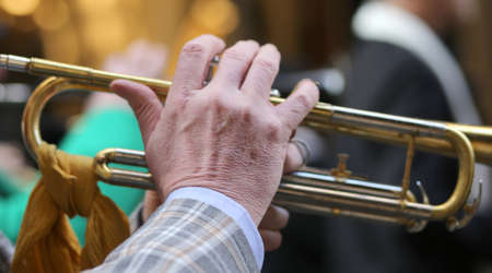 hand of elderly man playing the trumpet in the music band during the sound performance Stock Photo