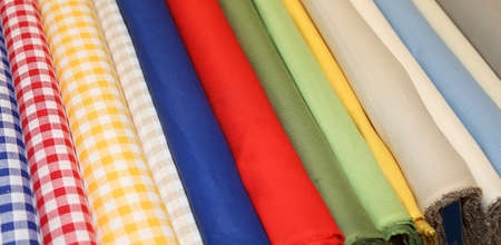 Background Of Very Colorful Fabrics In The Dress Shop For Dresses Or Trendy  Tablecloths Stock Photo