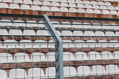 Robust metal fence in the stadium to split the fans on the pitches from the players during the sports meetings Stock Photo