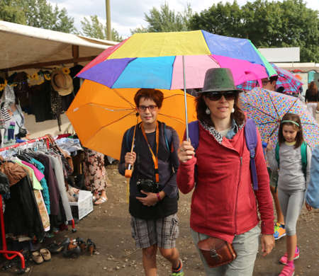 family walking to the market with umbrella during a rainy day Stock fotó - 85546209