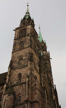 bell tower of  St. Lawrence Church a medieval church in the old town of Nuremberg Bavaria Germany Stock Photo
