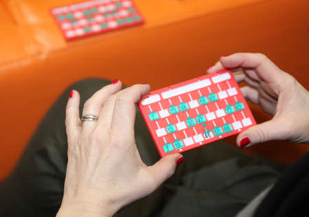 bingo scorecards and the hand of a woman player