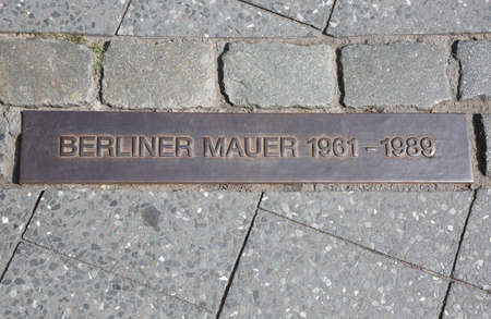 big Commemorative plaque embedded in the sidewalks to indicate the path of the Berlin Wall