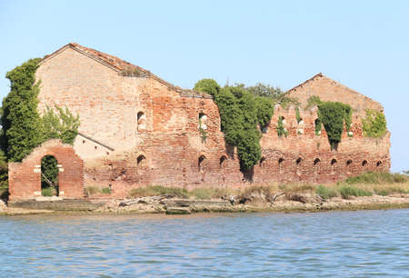 Ruin of a destroyed old brick home in the lagoon near venice