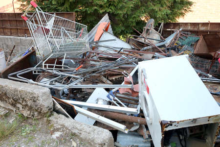 rusty shopping trolley in recycling of ferrous material for disposal