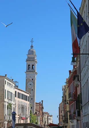 pendent: White and leaning bell tower of the church of Saint George of the Greeks in Venice in Italy