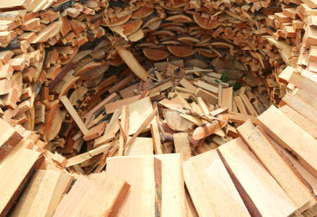 large woodshed circular shape with many pieces of wood cut to warm up during the winter