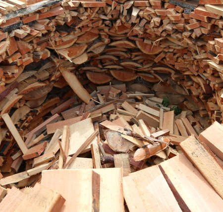 large circular wood-burning wood with many pieces of wood cut to warm up during the winter