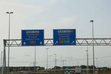 road sign on the highway to reach amsterdam in Holland in northern Europe