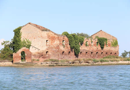 Ruin of a destroyed old brick home in the lagoon Stock Photo