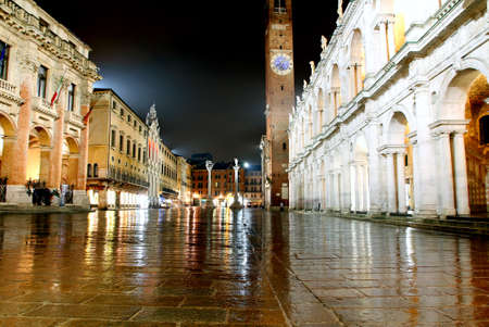 Main city square and palladian basilica with tower at night in Vicenza Italy