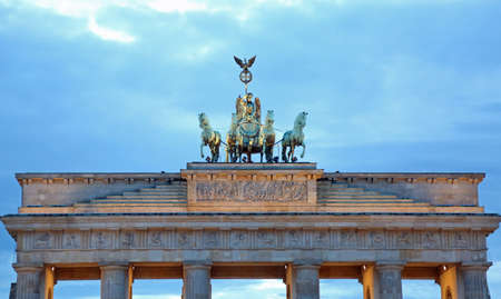 quadriga: Great Brandenburg Gate of Berlin Symbol with Quadriga with four Horses and Victory Chariot