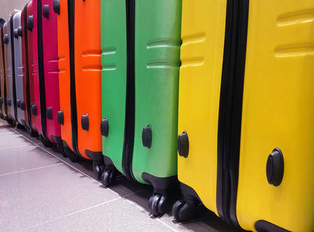 Colorful suitcases in the luggage storage at the airport to control the transport material