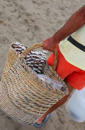 seller of coconut and fresh fruit on the beach of the tourist resort