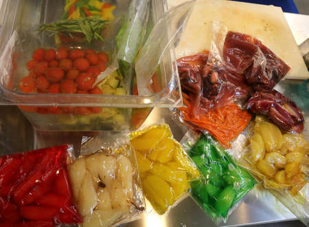 red tomatoes onions carrots apples pears and other cooked vegetables are vacuum packaged in special hermetic containers