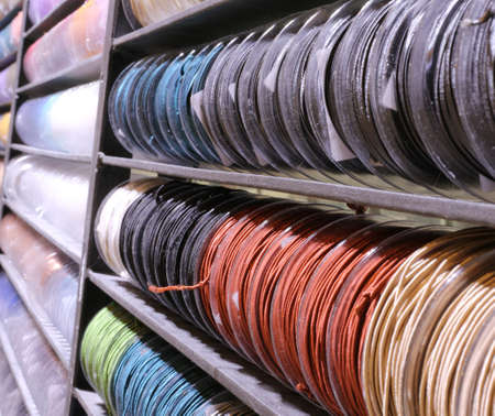 many lanyard rolls of many colors on sale in the hobby and tailor shop Фото со стока