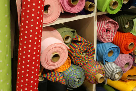 sale of fabrics of many varieties in the textiles and fabrics shop Reklamní fotografie