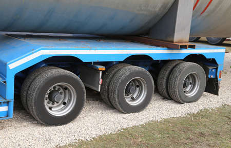 huge lorry for transport of heavy goods with two couples of wheels for axis Stock Photo