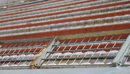 Robust metal protection net in the stadium to separate fans on the stairs from the players during the sporting matches