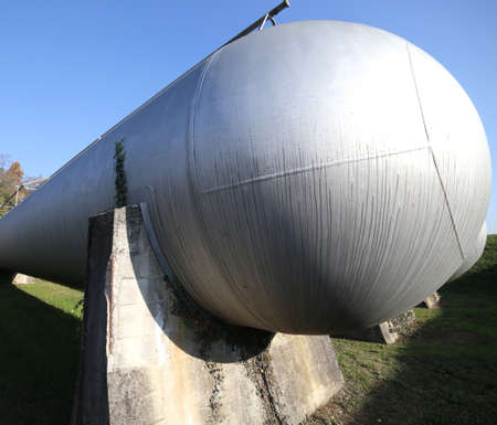 Huge gas storage tanks in an industrial area. Large cylinders are used to store gas during energy crises or supply problems.