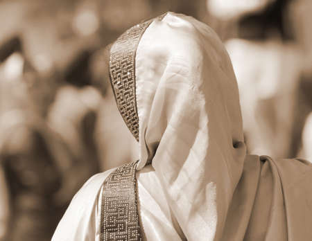 woman with veil over her head with sepia tone effect Stock Photo