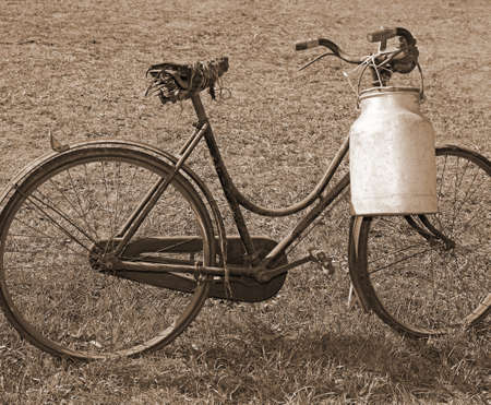 ancient milking bike with aluminum bin for milk transport and speia effect