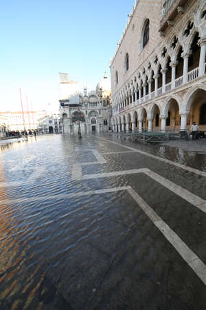 Saint Mark square and Doges Palace with high tide in winter in Venice Italy