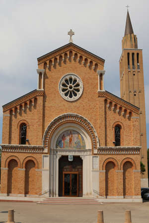 church steeple: Bell Tower and facade of  Church called Chiesa di San Giovanni Battista in Jesolo City Northen Italy Stock Photo