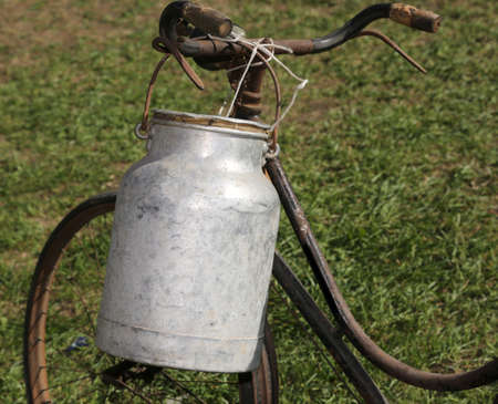 Antique milk can aluminum used once a long time ago from the milkman to deliver the beverage to the dairy