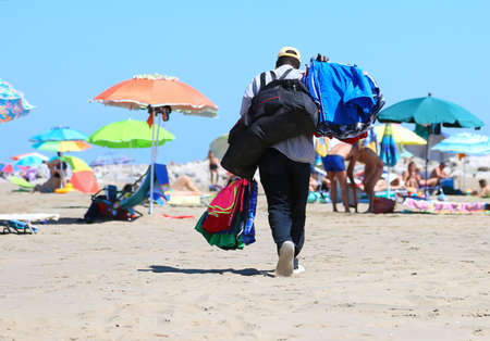 African abusive towel and shorts seller in the resort beach Stock Photo