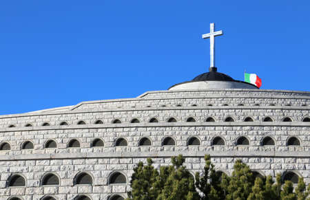 ample: Vicenza, VI, Italy - December 8, 2015: War Memorial of First War World called Ossario del Monte Grappa. Many graves of italian fallen soldiers and the cross over a church