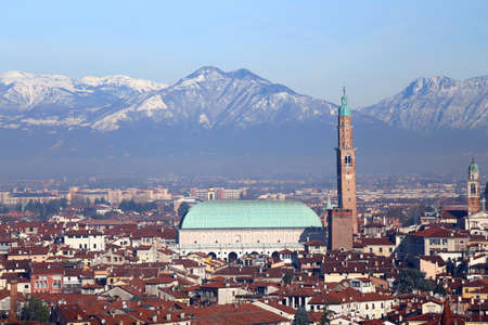 roofs of the houses and the historic monument called BASILICA PALLADIANA in Vicenza City in Italy venue of the exhibition of Van Gogh paintings Stock Photo