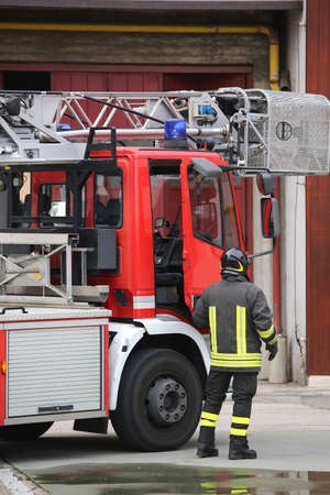 firefighter and fire truck in barracks during a firefighting exercise Stock Photo
