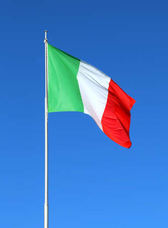 Italian flag waving with blue sky in the background
