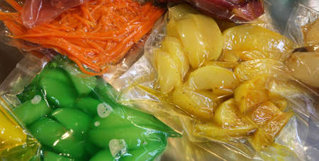 carrots apples pears and other vegetables are vacuum packaged in special hermetic containers Stock Photo