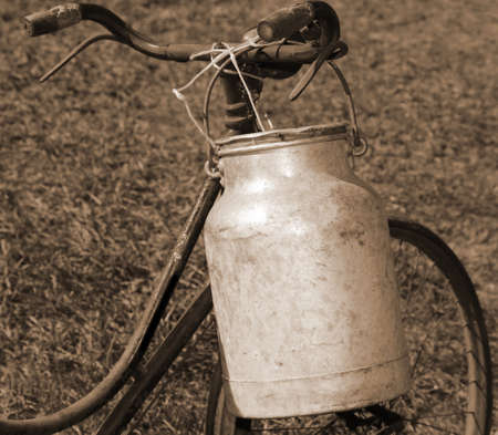 old bicycle milkman with aluminum bin for transporting the milk from the dairy farm