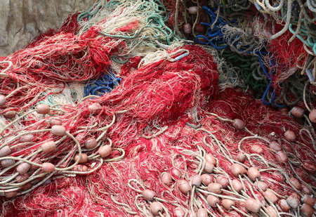 background of many fishing nets with floats used to fish at sea