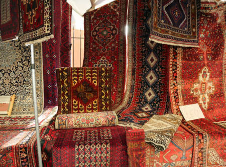 Stall of Asian and North African carpet for sale Stok Fotoğraf