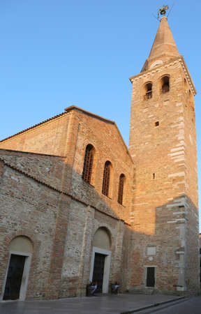 church steeple: ancient church and bell tower of Santa Eufemia in the city called GRADO in Northern Italy